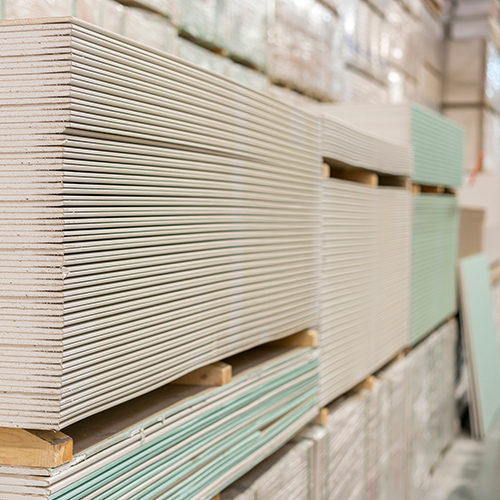 Pallets of plasterboard in a warehouse
