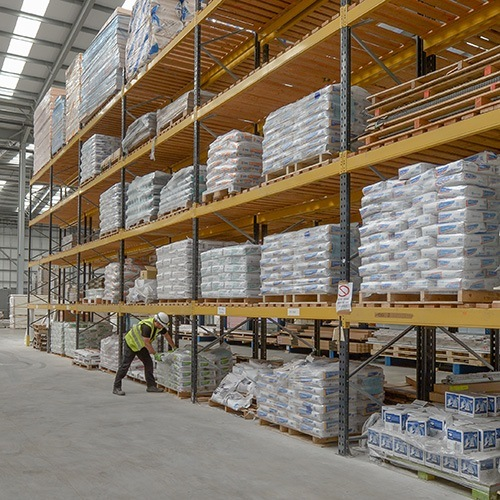 Bags of plaster in a warehouse