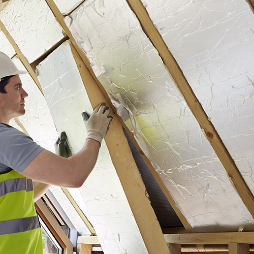 PIR insulation boards being installed into a pitched roof