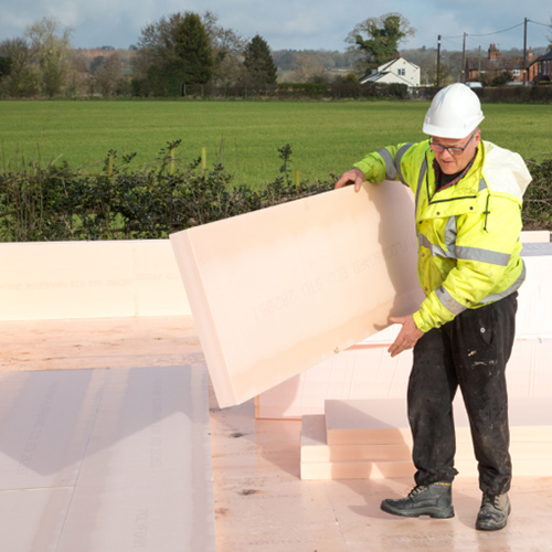 Solid floor insulation being installed on site