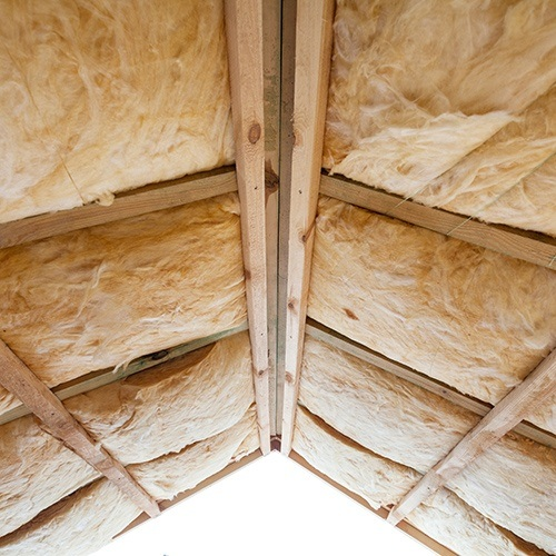 Mineral wool insulation installed into a pitched roof