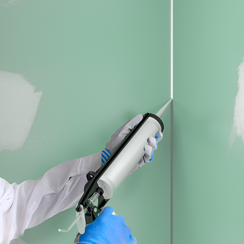 Application of mastic to a drywall installation