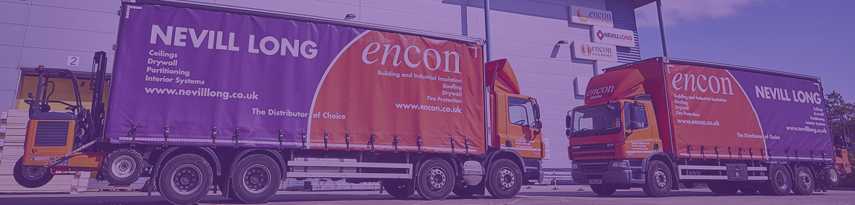 Encon and Nevill Long trucks in warehouse yard